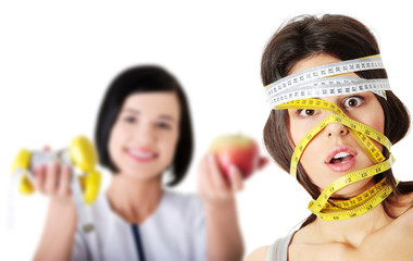 Woman with measuring tape around her head