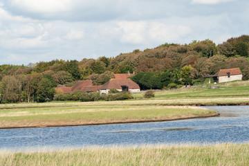 Ancient Sussex flint barns nestling in woodland