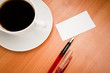 blank card with pencil on coffee cup with space for your data