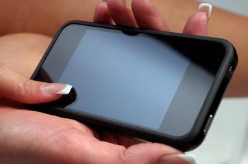 Woman hand holding smartphone