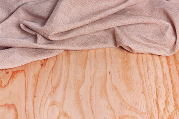 Wood and folded fabric texture background