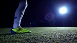 Soccer Player Kicks Ball