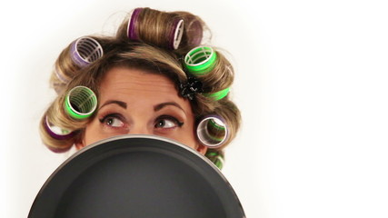 Funny Housewife with hair curlers shoots with eyes
