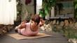 Girl doing Yoga  Cobra Pose spine exercise near Spa Center Pool