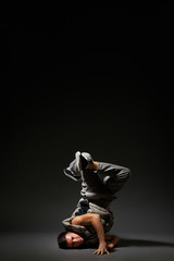breakdancer posing over dark