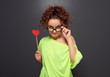 woman in glasses with red heart
