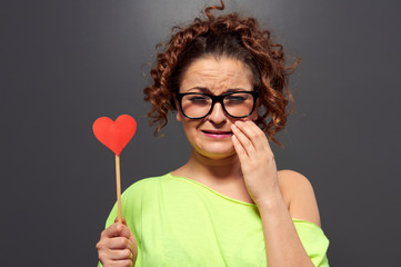 woman in glasses with broken heart