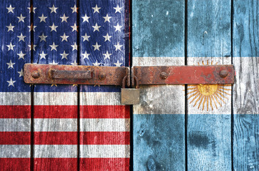 USA and Argentine flag on the background of old locked doors