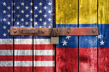 USA and Venezuelan flag on the background of old locked doors