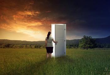 Woman walking through door