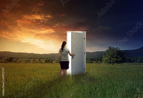Woman walking through door