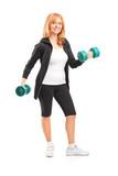 Full length portrait of a mature woman lifting up dumbbells