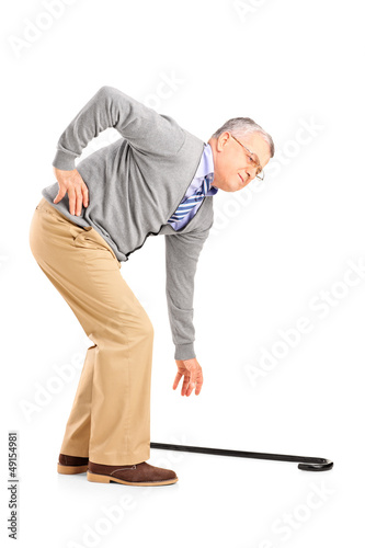 Full length portrait of a senior man with back pain trying to pi