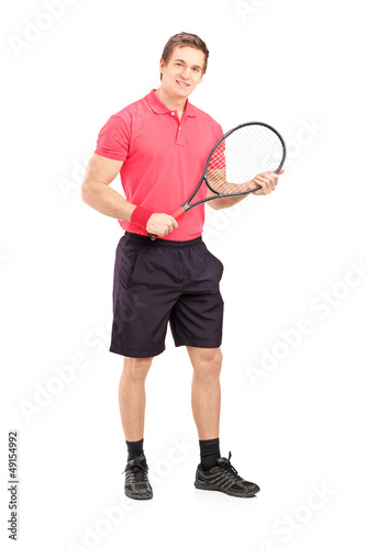 Full length portrait of a young man holding a tennis racket
