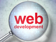 Web development SEO concept: optical glass with words Web Develo