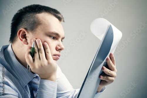 Businessman reading office document