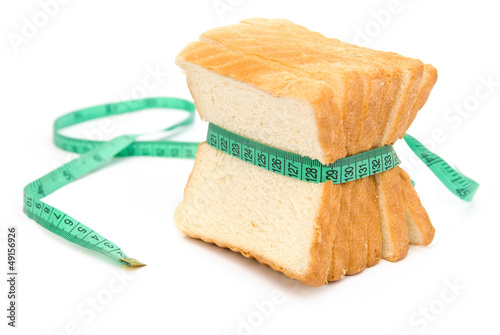 bread grasped by measuring tape