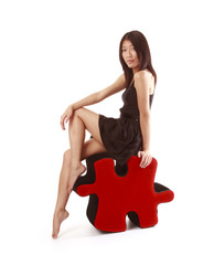 girl sitting on piece of puzzle