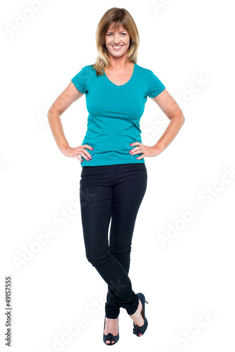 Stylish portrait of trendy casual woman, legs crossed