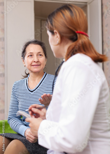 mature woman complaining  to doctor