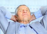 Businessman in age, resting for a break