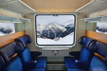 Interior of train and mountains in window