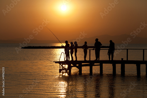 young children are at sunset in ayvalik turkey