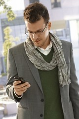 Young businessman with mobilephone