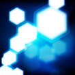 Abstract blue background with hexagons bokeh defocused lights.