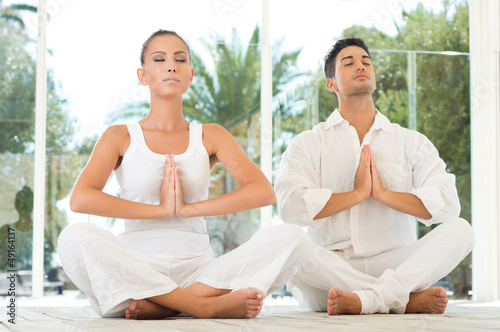 Serene Couple Doing Yoga