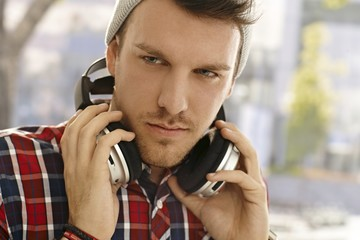 Closeup portrait of young guy with headphones