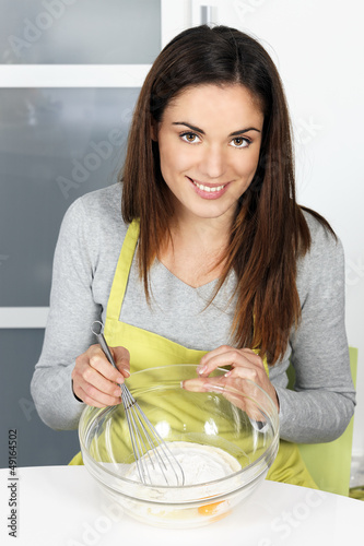 Woman whisking batter