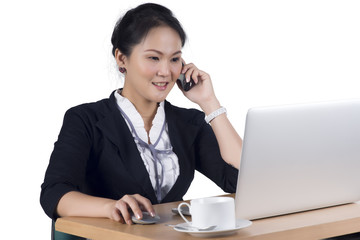 Portrait of business woman speaking on mobile phone while using
