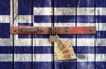 Greek flag with money on the background of old locked doors