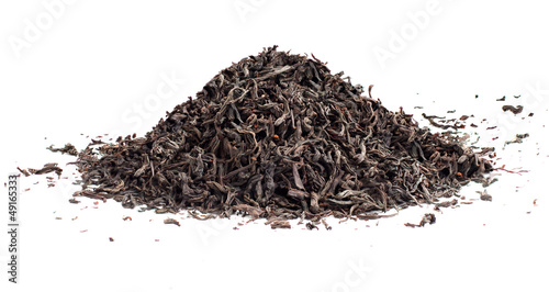 Black tea loose dried tea leaves, isolated on the white