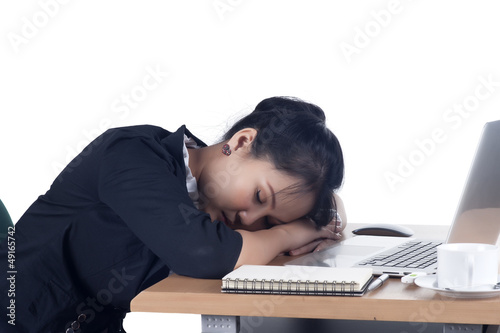 Tired business woman sleeping at her desk.