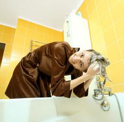 Girl in a bathrobe wash head