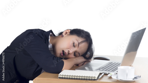 Tired business woman sleeping at her desk