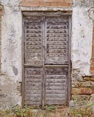 old worn door of a typical Mediterranean island house