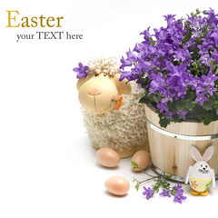 Easter sheep with easter decoration and flowers
