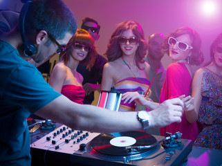 dj playing music with turntables   sunglasses  colorful lights