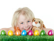 canvas print picture - Cute blonde child is happy to have her Easter eggs and bunny