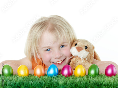 canvas print picture Cute blonde child is happy to have her Easter eggs and bunny