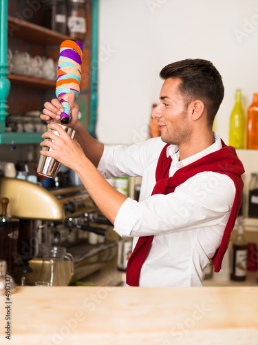 handsome bartender preparing a drink