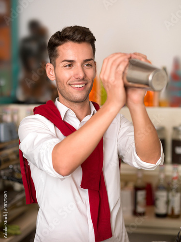attractive bartender mixing a drink