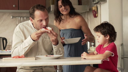 Happy family during breakfast in kitchen