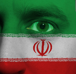 face with the Iranian flag painted on it