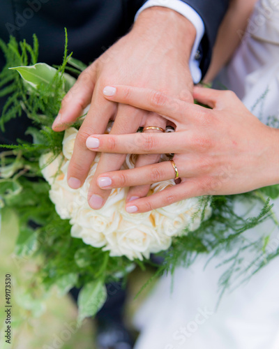 wedding rings with hands