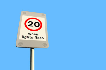 20mph speed limit sign on blue sky background
