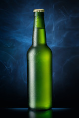 Bottle of beer on blue